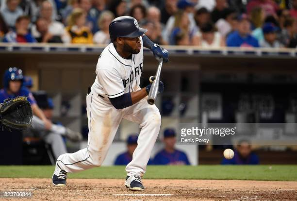 Manuel Margot of the San Diego Padres hits a bunt single during the fourth inning of a baseball game against the New York Mets at PETCO Park on July...