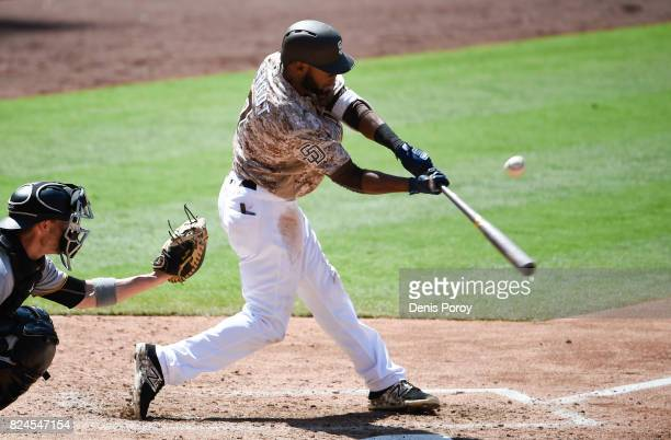 Manuel Margot of the San Diego Padres hits a double during the fifth inning of a baseball game against the Pittsburgh Pirates at PETCO Park on July...