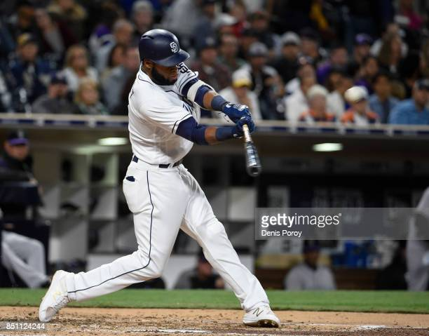 Manuel Margot of the San Diego Padres hits a double during the third inning of a baseball game against the Colorado Rockies at PETCO Park on...