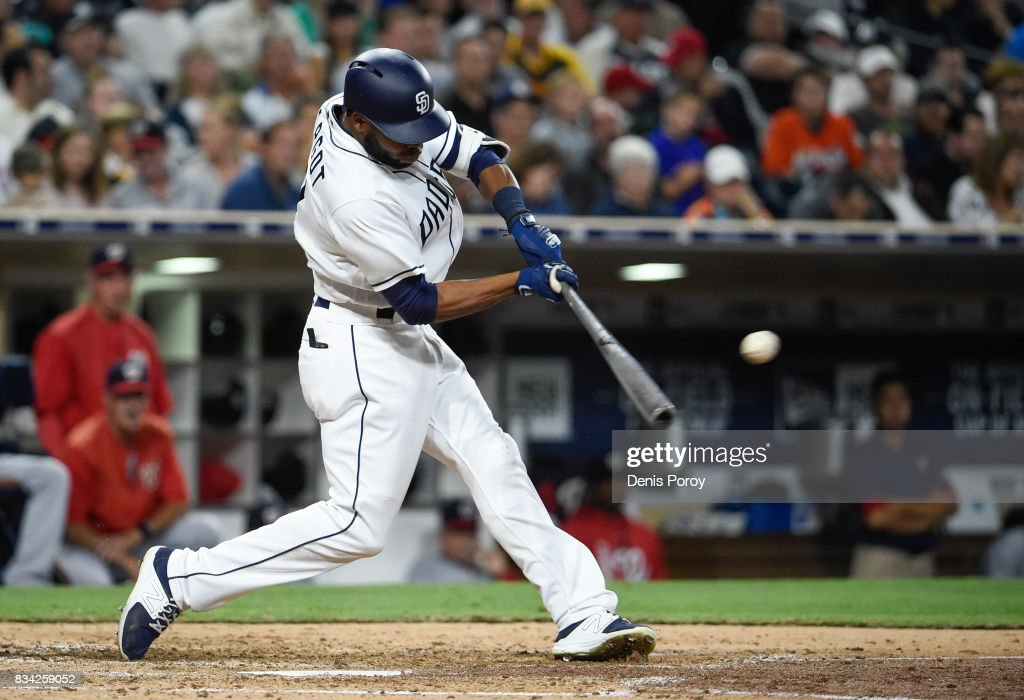 Manuel Margot #7 of the San Diego Padres hits a single during the fifth inning of a baseball game against the Washington Nationals at PETCO Park on August 17, 2017 in San Diego, California.