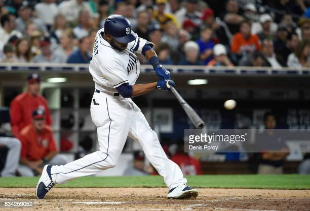 Manuel Margot of the San Diego Padres hits a single during the fifth inning of a baseball game against the Washington Nationals at PETCO Park on...
