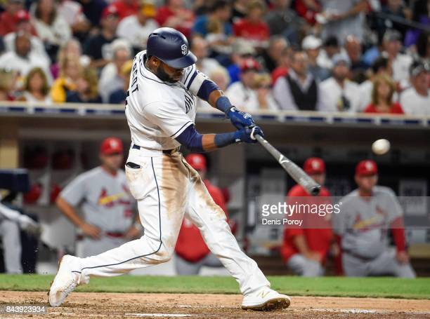 Manuel Margot of the San Diego Padres hits a single during the fourth inning of a baseball game against the St Louis Cardinals at PETCO Park on...