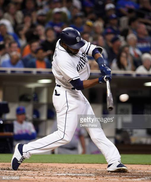 Manuel Margot of the San Diego Padres hits a triple during the third inning of a baseball game against the New York Mets at PETCO Park on July 26...