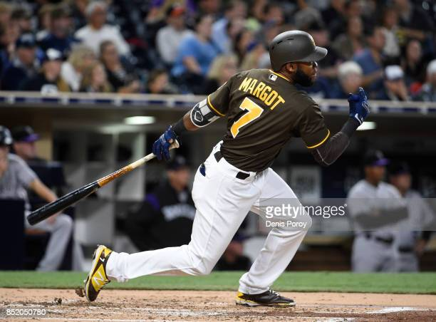 Manuel Margot of the San Diego Padres hits a triple during the third inning of a baseball game against the Colorado Rockies at PETCO Park on...