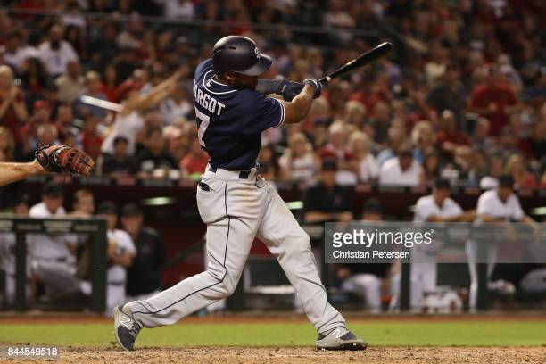 Manuel Margot of the San Diego Padres hits a two RBI single against the Arizona Diamondbacks during the seventh inning of the MLB game at Chase Field...