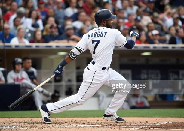 Manuel Margot of the San Diego Padres hits an RBI double during the third inning of a baseball game against the Atlanta Braves at PETCO Park on June...
