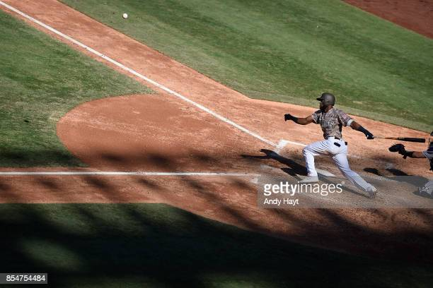 Manuel Margot of the San Diego Padres hits during the game against the Colorado Rockies at Petco Park on September 24 2017 in San Diego California