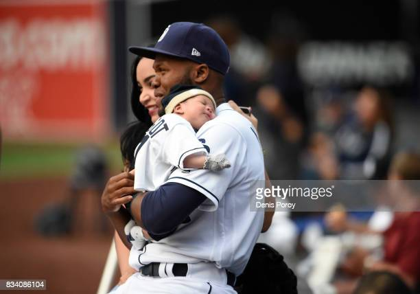 Manuel Margot of the San Diego Padres holds his son Diamond before a baseball game against the Philadelphia Phillies at PETCO Park on August 14 2017...