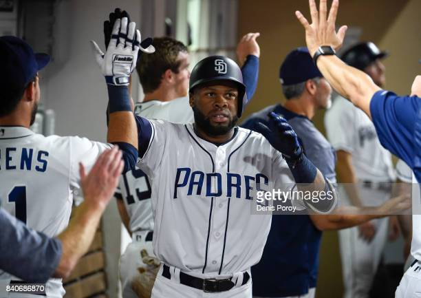 Manuel Margot of the San Diego Padres is congratulated after hitting a threerun home run during the fourth inning of a baseball game against the San...