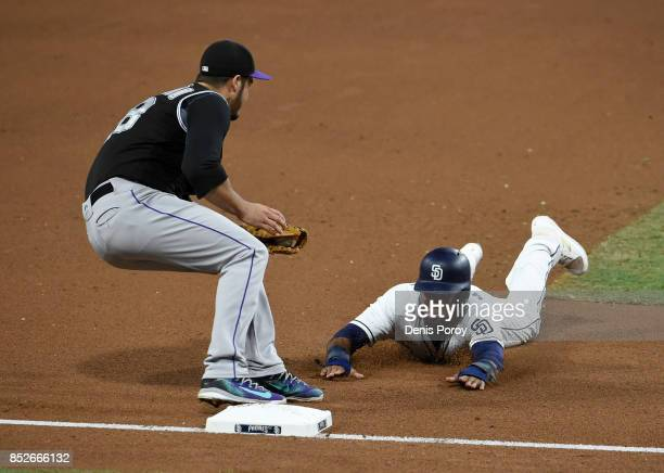 Manuel Margot of the San Diego Padres is tagged out at thrd base by Nolan Arenado of the Colorado Rockies as he tries to steal during the fifth...