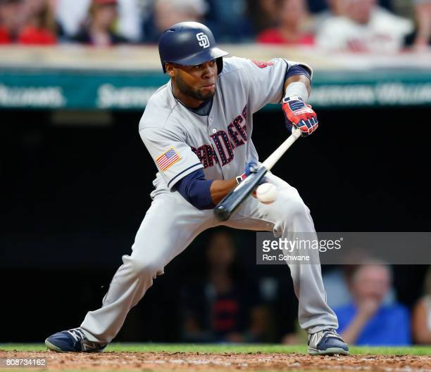 Manuel Margot of the San Diego Padres lays down a sacrifice bunt against Corey Kluber of the Cleveland Indians during the sixth inning at Progressive...