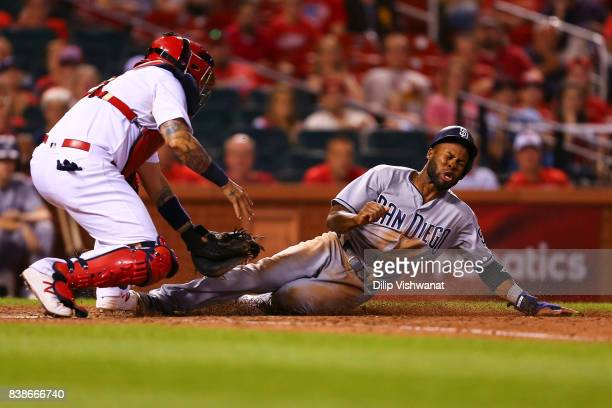 Manuel Margot of the San Diego Padres scores a run against the St Louis Cardinals in the ninth inning at Busch Stadium on August 24 2017 in St Louis...