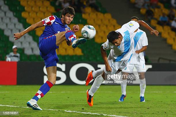 Manuel Moreno of Guatemala tries to score against Frano Mlinar of Croatia during the FIFA U20 World Cup 2011 Group D match between Croatia and...