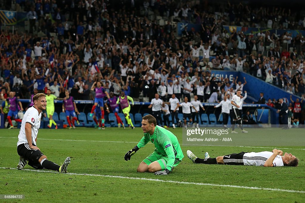 Manuel Neuer and Bastian Schweinsteiger of Germany react after Antoine Griezmann of France scored a goal to make the score 02 during the UEFA Euro...