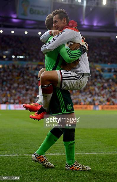 Manuel Neuer and Miroslav Klose of Germany celebrate their team's first goal during the 2014 FIFA World Cup Brazil Final match between Germany and...