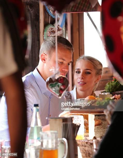 Manuel Neuer and Nina Weiss attend the 'FC Bayern Muenchen Wiesn' during Oktoberfest 2015 at Kaeferschaenke on September 30 2015 in Munich Germany