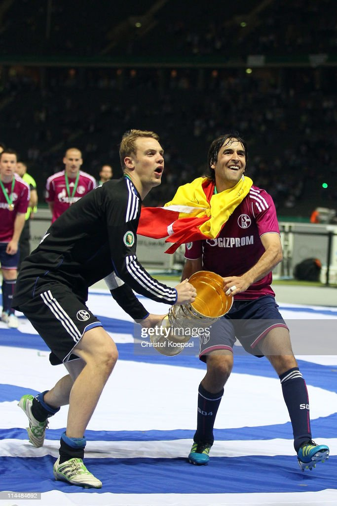 Manuel Neuer and Raúl Gonzalez of Schalke lift the cup afdter winning 50 the DFB Cup final match between MSV Duisburg and FC Schalke 04 at Olympic...
