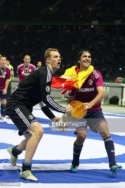 Manuel Neuer and Raúl Gonzalez of Schalke lift the cup afdter winning 50 the DFB Cup final match between MSV Duisburg and FC Schalke 04 at Olympic...