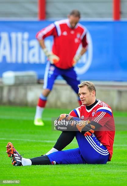 Manuel Neuer and Tom Starke of Muenchen warm up during a training session of FC Bayern Muenchen on August 20 2014 in Munich Germany