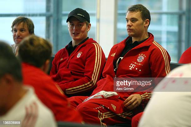 Manuel Neuer and Toni Kroos of Muenchen wait for their team's departure to the training camp in Doha at Munich airport on January 2 2012 in Munich...