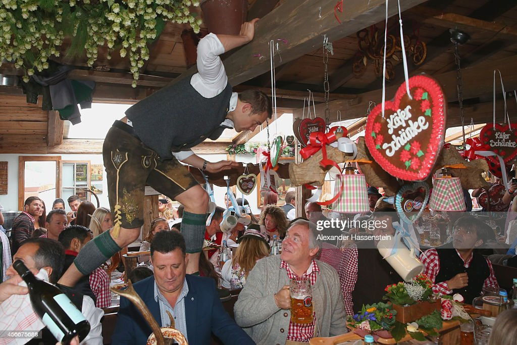 fc bayern muenchen attends oktoberfest 2014 getty images. Black Bedroom Furniture Sets. Home Design Ideas