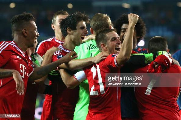Manuel Neuer keeper of Bayern Muenchen celebrates victory with his team mate Philipp Lahm and others after the UEFA Super Cup between FC Bayern...