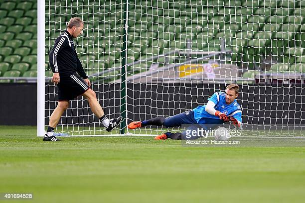 Manuel Neuer keeper of Germany and assistent coach Andreas Koepcke during a training session of the German national football team at Aviva Stadium on...