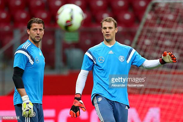 Manuel Neuer keeper of Germany looks on with his team mate Roman Weidenfeller during a training session ahead of their UEFA EURO 2016 qualifying...