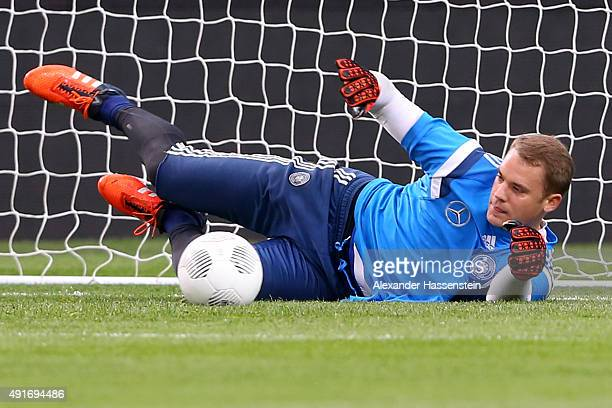 Manuel Neuer keeper of Germany safes the ball during a training session of the German national football team at Aviva Stadium on October 7 2015 in...