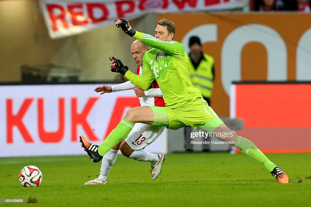 Manuel Neuer, keeper of Muenchen battles for the ball with Tobias Werner of Augsburg during the Bundesliga match between FC Augsburg and FC Bayern Muenchen at SGL Arena on December 13, 2014 in Augsburg, Germany.