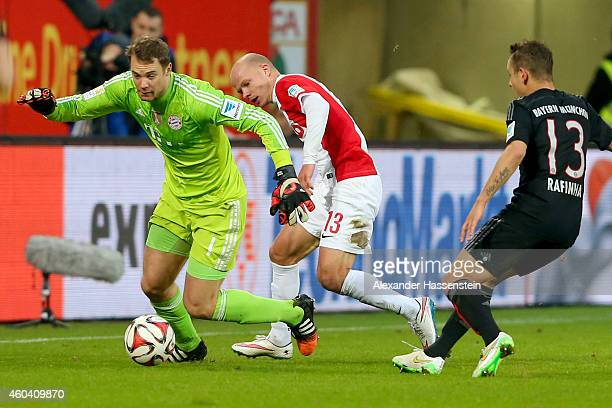Manuel Neuer keeper of Muenchen battles for the ball with Tobias Werner of Augsburg during the Bundesliga match between FC Augsburg and FC Bayern...