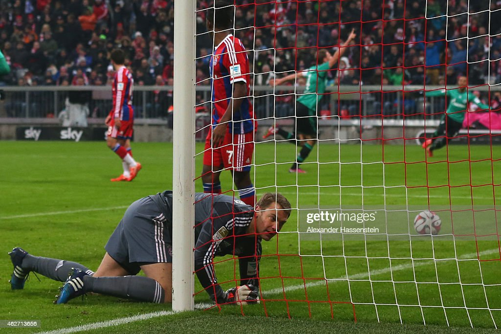 <a gi-track='captionPersonalityLinkClicked' href=/galleries/search?phrase=Manuel+Neuer&family=editorial&specificpeople=764621 ng-click='$event.stopPropagation()'>Manuel Neuer</a>, keeper of Muenchen reacts whilst <a gi-track='captionPersonalityLinkClicked' href=/galleries/search?phrase=Benedikt+Hoewedes&family=editorial&specificpeople=3945465 ng-click='$event.stopPropagation()'>Benedikt Hoewedes</a> ((R) of Schalke celebrates the first team goal during the Bundesliga match between FC Bayern Muenchen and FC Schalke 04 at Allianz Arena on February 3, 2015 in Munich, Germany.