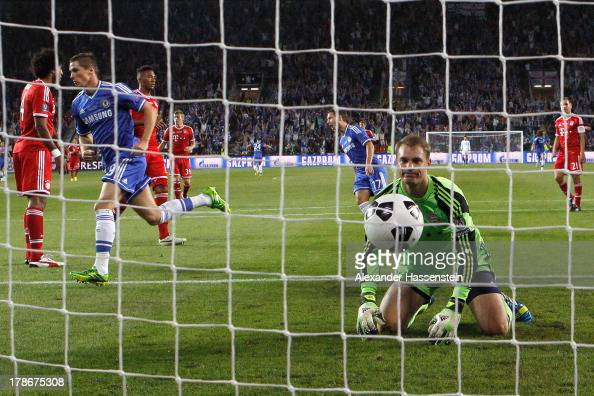 Manuel Neuer keeper of Muenchen reacts whilst Fernando Torres of Chelsea celebrates scoring the opening goal during the UEFA Super Cup between FC...