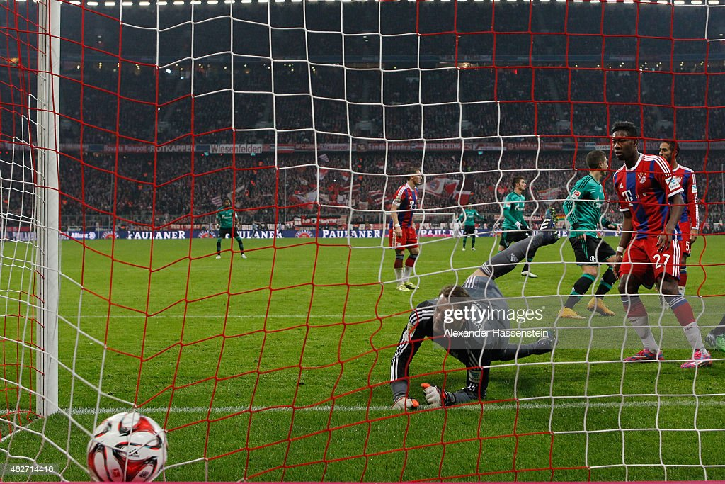 <a gi-track='captionPersonalityLinkClicked' href=/galleries/search?phrase=Manuel+Neuer&family=editorial&specificpeople=764621 ng-click='$event.stopPropagation()'>Manuel Neuer</a>, keeper of Muenchen reacts with his team mate <a gi-track='captionPersonalityLinkClicked' href=/galleries/search?phrase=David+Alaba&family=editorial&specificpeople=5494608 ng-click='$event.stopPropagation()'>David Alaba</a> after receiving the first goal during the Bundesliga match between FC Bayern Muenchen and FC Schalke 04 at Allianz Arena on February 3, 2015 in Munich, Germany.
