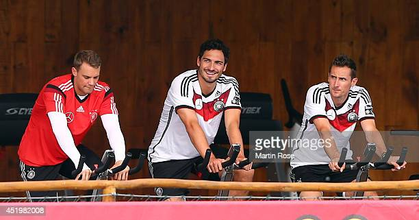 Manuel Neuer Mats Hummels Miroslav Klose of Germany look on during the German national team training session at Campo Bahia on July 10 2014 in Santo...