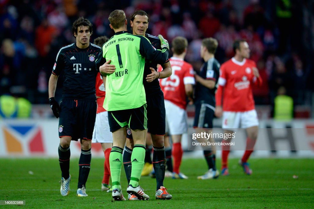 <a gi-track='captionPersonalityLinkClicked' href=/galleries/search?phrase=Manuel+Neuer&family=editorial&specificpeople=764621 ng-click='$event.stopPropagation()'>Manuel Neuer</a> of Bayern and teammate <a gi-track='captionPersonalityLinkClicked' href=/galleries/search?phrase=Daniel+van+Buyten&family=editorial&specificpeople=213252 ng-click='$event.stopPropagation()'>Daniel van Buyten</a> hug after the Bundesliga match between 1. FSV Mainz 05 and FC Bayern Muenchen at Coface Arena on February 2, 2013 in Mainz, Germany.