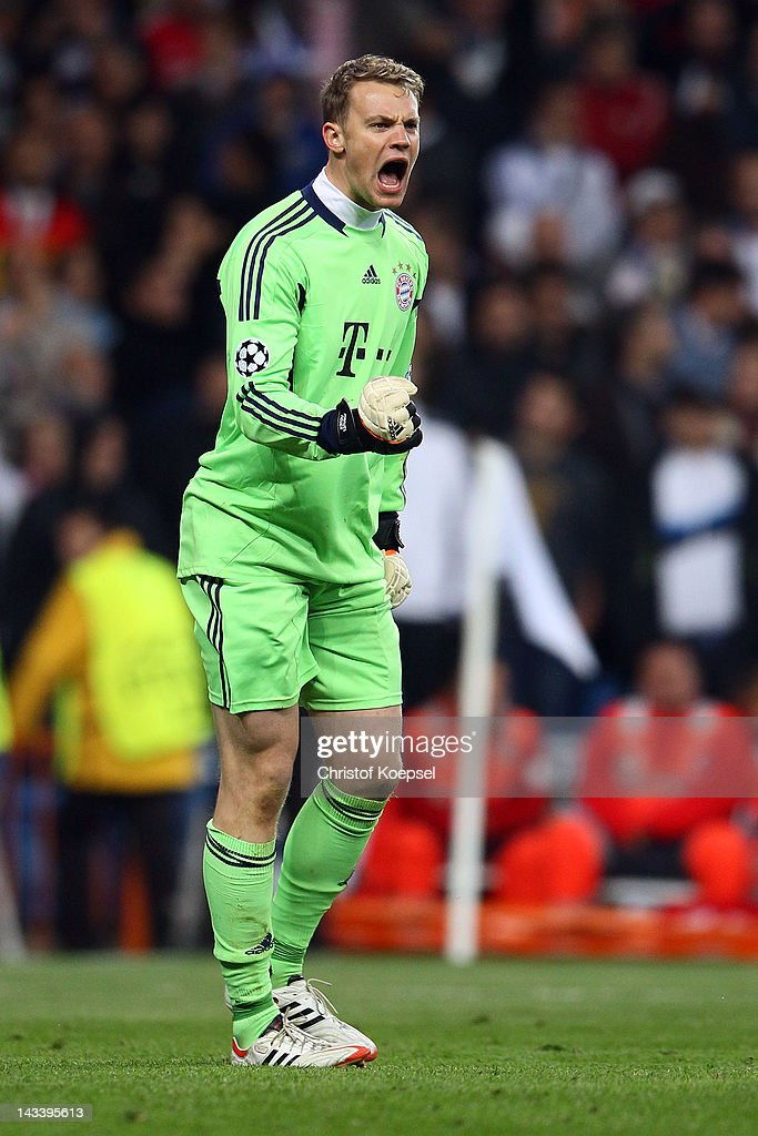 Manuel Neuer of Bayern celebrates after saving a penalty of Cristiano Ronaldo of Real Madrid (not in the picture) during the UEFA Champions League semi final second leg match between Real Madrid and Bayern Muenchen at Bernabeu Stadium on April 25, 2012 in Madrid, Spain.