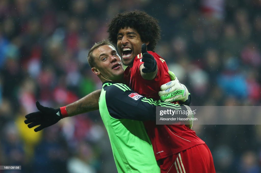 Manuel Neuer of Bayern Muenchen and team mate Dante celebrate their team's seventh goal during the Bundesliga match between FC Bayern Muenchen and Hamburger SV at Allianz Arena on March 30, 2013 in Munich, Germany.