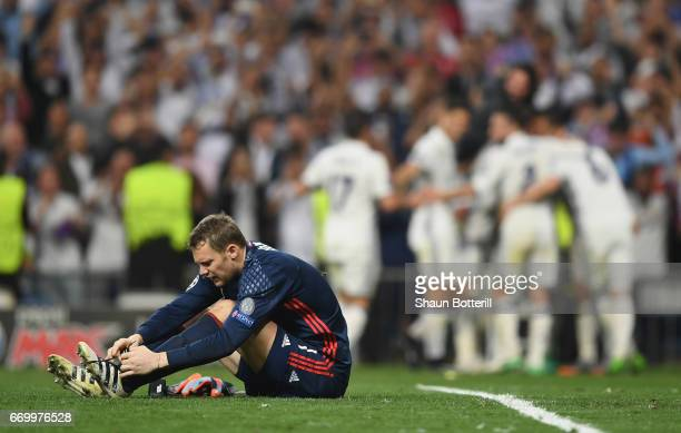 Manuel Neuer of Bayern Muenchen reacts after Cristiano Ronaldo of Real Madrid scores his sides third goal and hatrick goal during the UEFA Champions...