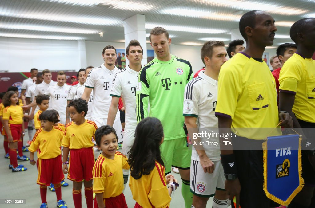 Manuel Neuer of Bayern Muenchen winks at a mascot before the FIFA Club World Cup Semi Final match between Guangzhou Evergrande FC and Bayern Muenchen...