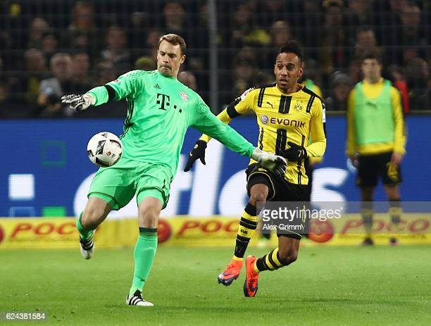 Manuel Neuer of Bayern Munich is chased down by PierreEmerick Aubameyang of Borussia Dortmund during the Bundesliga match between Borussia Dortmund...