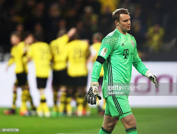 Manuel Neuer of Bayern Munich is dejected after letting in the opening goal from PierreEmerick Aubameyang of Borussia Dortmund during the Bundesliga...