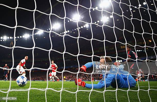 Manuel Neuer of Bayern Munich makes a save from Theo Walcott of Arsenal during the UEFA Champions League Group F match between Arsenal FC and FC...