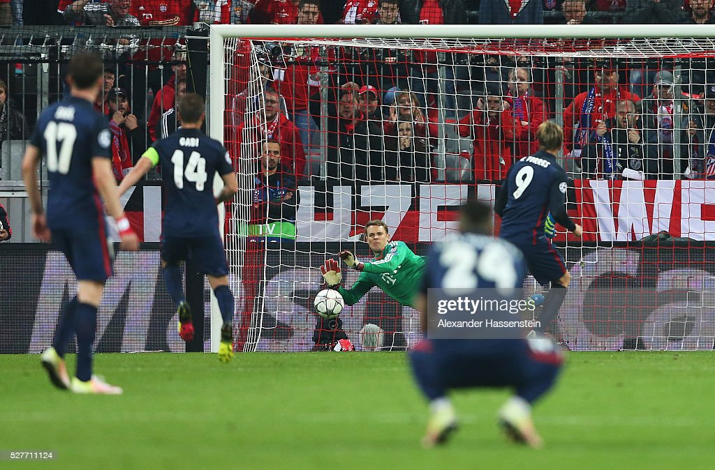 Manuel Neuer of Bayern Munich saves a penalty kick from Fernando Torres of Atletico Madrid (9) during UEFA Champions League semi final second leg match between FC Bayern Muenchen and Club Atletico de Madrid at Allianz Arena on May 3, 2016 in Munich, Germany.