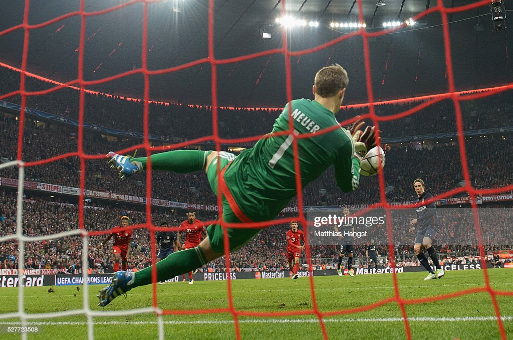 Manuel Neuer of Bayern Munich (1) saves a penalty kick from Fernando Torres of Atletico Madrid (9) during UEFA Champions League semi final second leg match between FC Bayern Muenchen and Club Atletico de Madrid at Allianz Arena on May 3, 2016 in Munich, Germany.