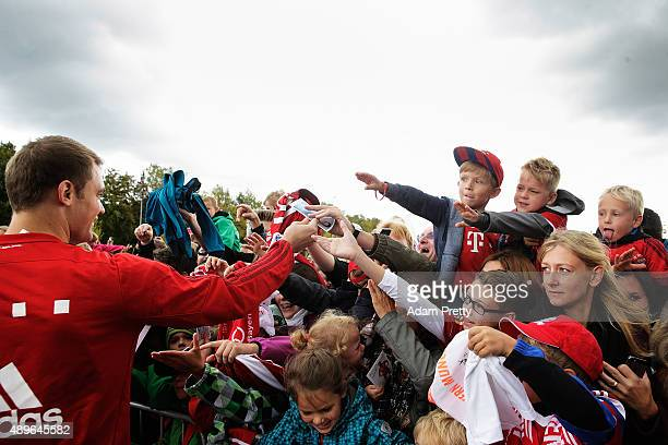 Manuel Neuer of Bayern Munich signs autographs before the Audi Driving Experience and the Audi to FC Bayern Muenchen new car handover event on...