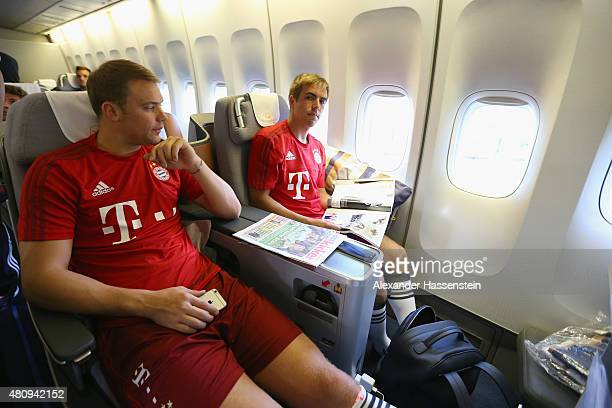 Manuel Neuer of FC Bayern Muenchen and his team mate Philipp Lahm on board on the team flight to Beijing for the FC Bayern Muenchen PreSeason Tour on...