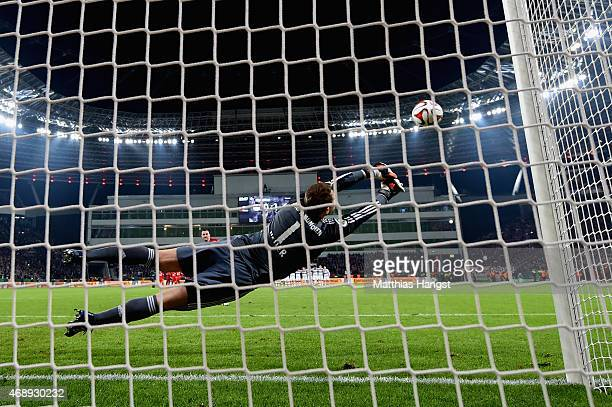 Manuel Neuer of FC Bayern Muenchen does a save during the penatly shootout during the DFB Cup Quarter Final match between Bayer Leverkusen and FC...