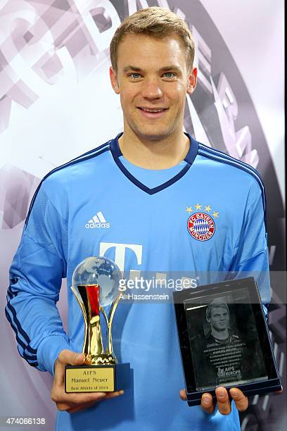 Manuel Neuer of FC Bayern Muenchen receives the AIPS 'Player of the Year 2014' award on May 20 2015 in Munich Germany