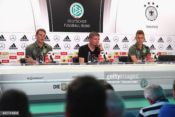 Manuel Neuer of Germany and his team mate Joshua Kimmich attends a Germany press conference at Ermitage Evian on June 24 2016 in EvianlesBains France